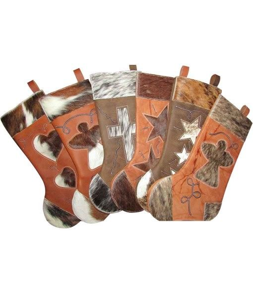 Gift Idea: Cowhide Christmas Stockings - Rustic Artistry is excited to introduce this new line of leather and hair-on-hide Christmas stockings. Each one is handcrafted from extra thick leather with a cowhide design insert.
