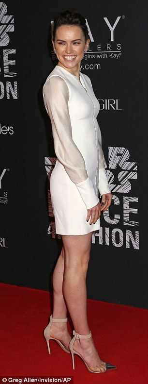 Wowing the crowd: Daisy flashed her smile and her toned legs at the red carpet event...