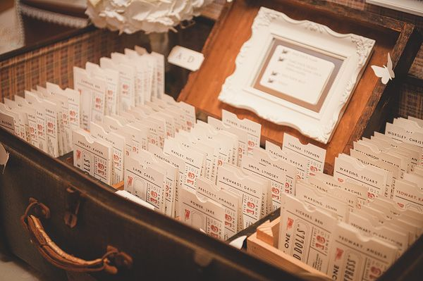 A glorious vintage broadway wedding. looooove this idea for people to find their tables at the reception.
