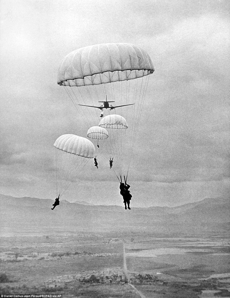 French paratroopers descend on the fortified outpost at Dien Bien Phu to provide reinforcements for soldiers trying to hold out against a siege by the Viet Minh, March 16, 1954