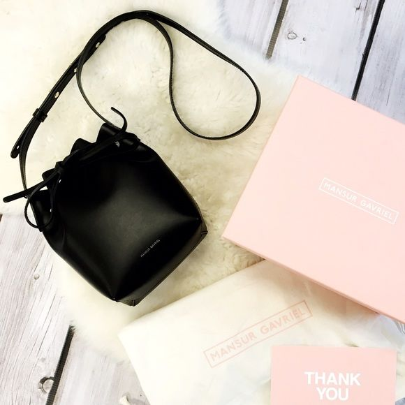 """SALE  Mansur Gavriel Mini Mini Bucket Bag This authentic Argento/Black Mansur Gavriel bag is the perfect gift for yourself or a friend. Comes with box and dust bag. Italian vegetable tanned black leather mini mini bucket bag with silver interior metallic patent. Adjustable strap. Made in Italy. 8"""" H X 6"""" W X 3.75"""" D. Price is firm. Mansur Gavriel Bags Mini Bags"""