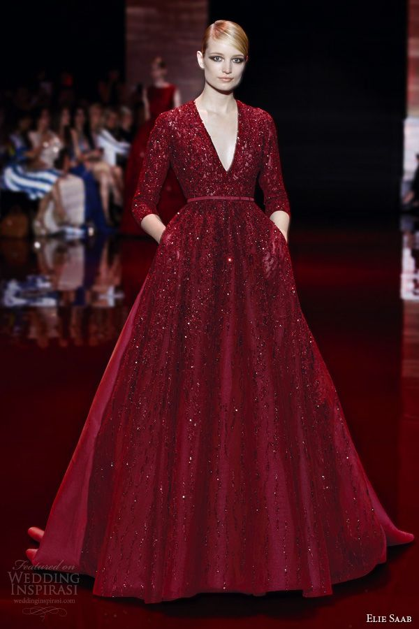 Elie Saab's Fall 2013 couture collection is the jewel toned gowns — in ruby, emerald and sapphire. Above, 3/4 sleeve V-neck ball gown with pockets; below, strapless knee-length dress. Love these reds.
