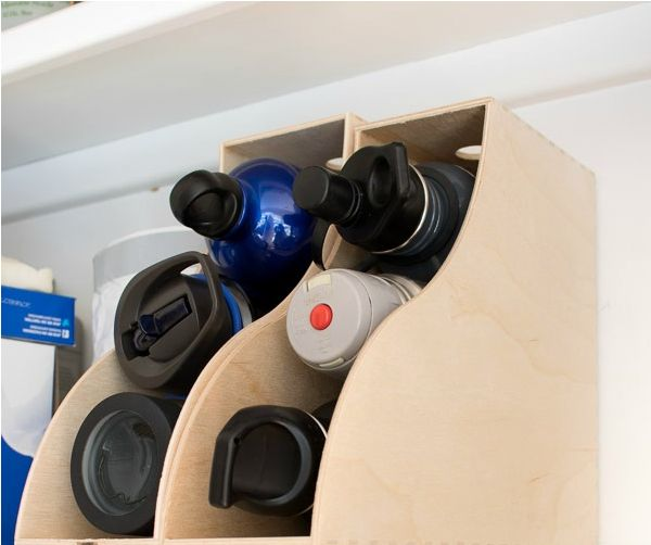 A set of magazine holders for organizing your re-useable water bottles.