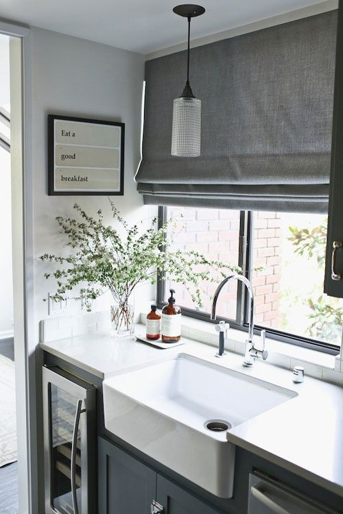 Farmhouse sink. Love the grays.