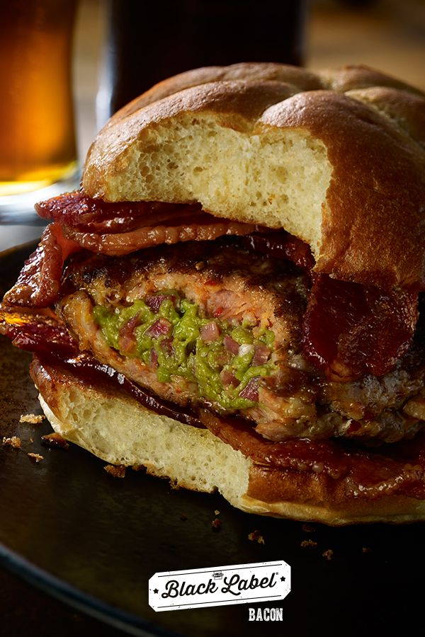 Bacon-Guac Stuffed Sausage Burger | A plate full of Wholly Guacamole bacon deliciousness. | Black Label® Bacon