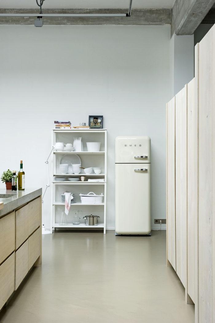 Smeg?  I love it! I've never heard of them, but that's an elegant little fridge.