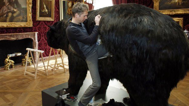 Abraham Poincheval climbs inside his bear at the Hunting and Wildlife Museum in Paris