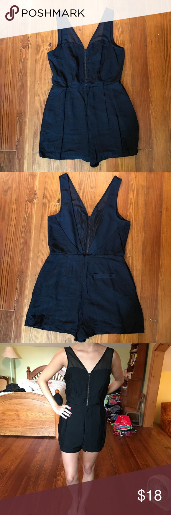 Black dressy BCBG romper NWOT. Perfect for many occasions, can be dressed up with heels or down with sandals. This sexy romper features a plunging V back line and straps that are mesh. Size 6. BCBGeneration Dresses
