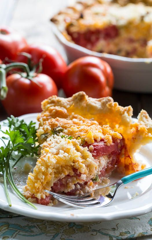 Savory Tomato Pie Recipe- a southern favorite. Juicy summer tomatoes mixed with mayonnaise and cheddar cheese. Serve warm.