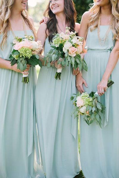 From the moment I laid eyes on these mint green bridesmaid dresses and lovely lush bouquets, I was head over heels in love with this wedding. It only took one p