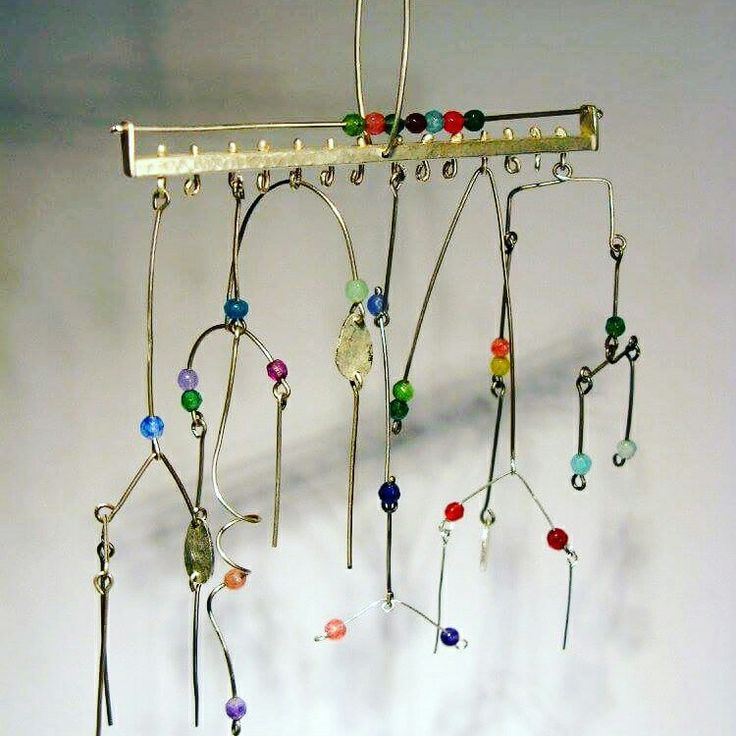 Kinetic pendant with calder mobiles