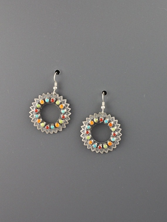 Coin silver earrings made from Pre-1965 silver quarters set with red coral, turquoise, orange spiney oyster shell and gaspeite chabochons. Hand stamped in a sun ray design.
