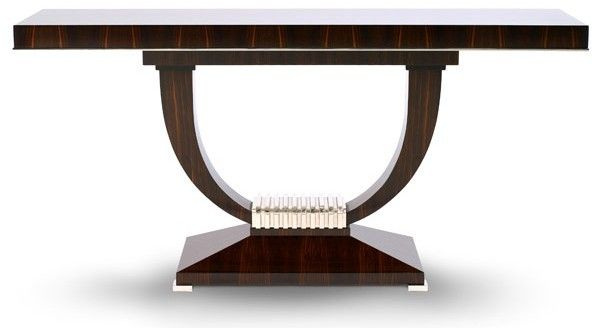 The Portman Table (AD497) A console table in macassar ebony. The rectangular top has an ebonised line inlay to the upper edge and a polished nickel moulding to the lower edge and stands on two shaped legs united by a castellated block in polished nickel on a facetted base. Specification 1800mm wide 400mm deep 840mm high