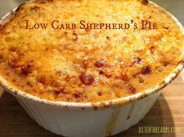 A low carb shepherd's pie with cauliflower mashed topping, is a great healthy alternative. Packed with tomatoes, carrots and cauliflower, this is a great winter dish. See more great recipes at ditchthecarbs.com