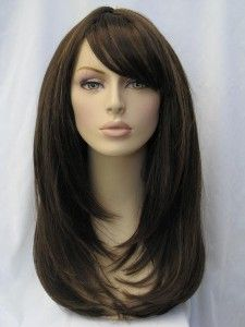 Catherine: a chocolate brown wig in razor cut face...