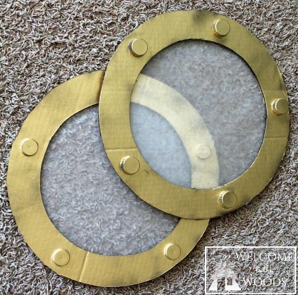 """A great photo tutorial on how to make an easy diy faux porthole. Cut out of cardboard, glue on bottle caps, spray paint, and the """"window"""" is wax paper."""
