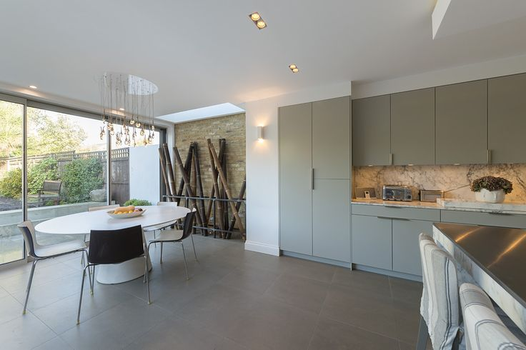 Family kitchen - Kensal Rise - London - Marble island - Stainless steel - pop up extractor.