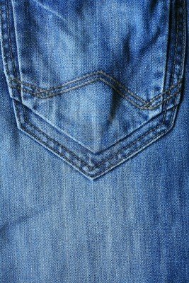 Textured background  closeup back pocket of blue denim male jeans  Stock Photo - 13504333