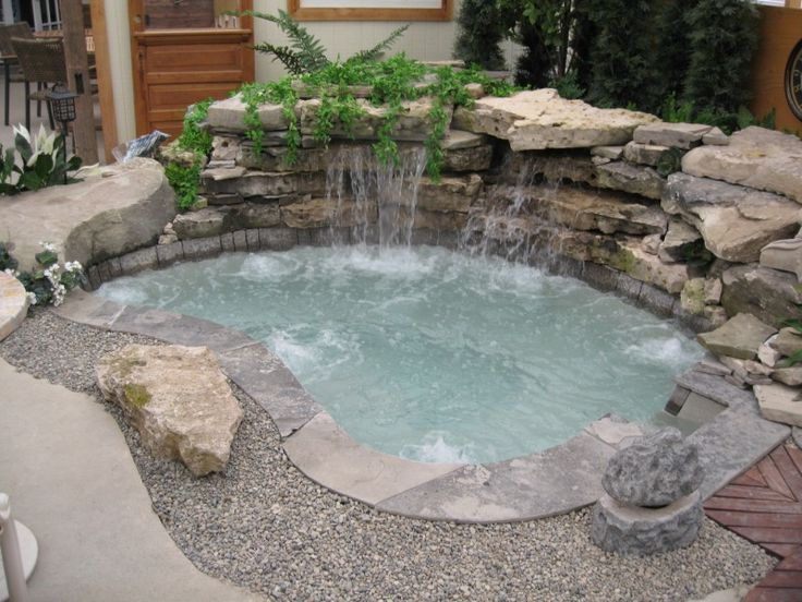 inground spa with waterfall