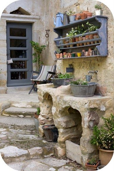 galvanized buckets used for potting bench sinks // there are no words to describe how badly I'd like to have a potting bench hand-carved from stone...