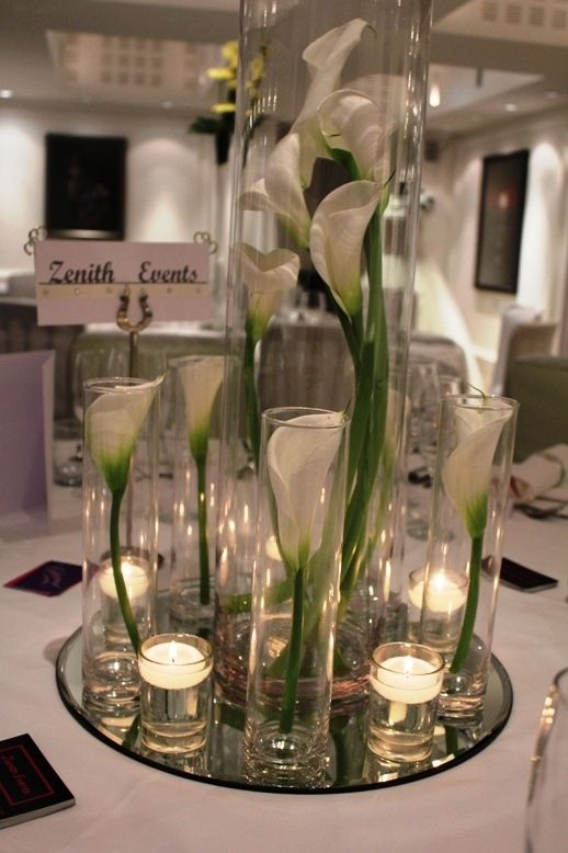 Mixed cylinder vases with elegant white calla lilies and