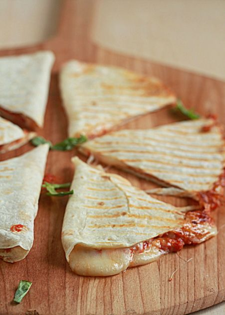 Four-Cheese Pizza Quesadillas with Optional Pepperoni. I made these in a frying pan.  A little messy but worth it.
