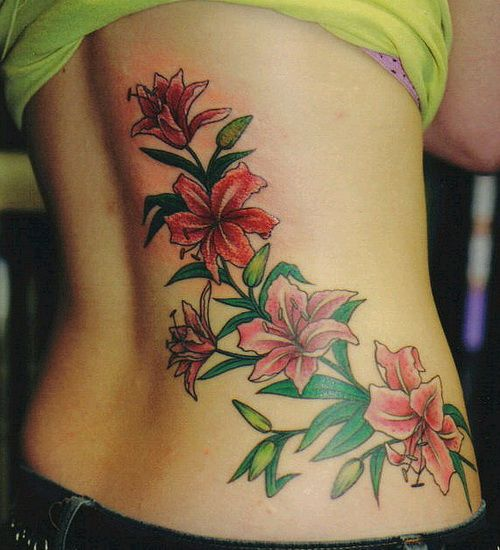 Lower Back Flower Tattoos Designs