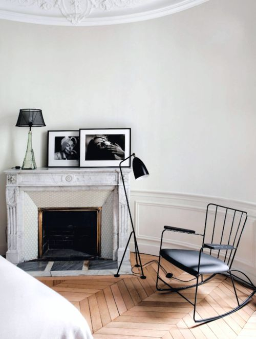 internalisecarlo:  Marble fireplace next to the most modern design elements, in thisunderstated and invitingmantel corner.