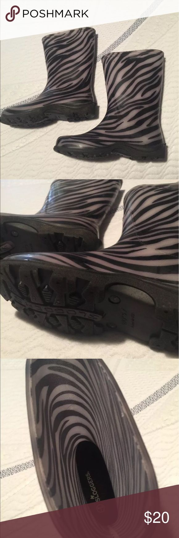 Zebra Print Sloggers Rubber Boots Zebra Print Sloggers brand rubber rain/garden boots size 7. Only worn a few times so they are in great condition! Super cute and comfortable! sloggers Shoes Winter & Rain Boots