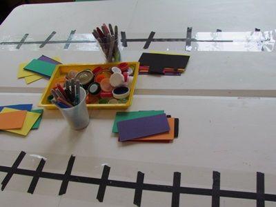 Playing on the tabletop train station in preschool   Teach Preschool