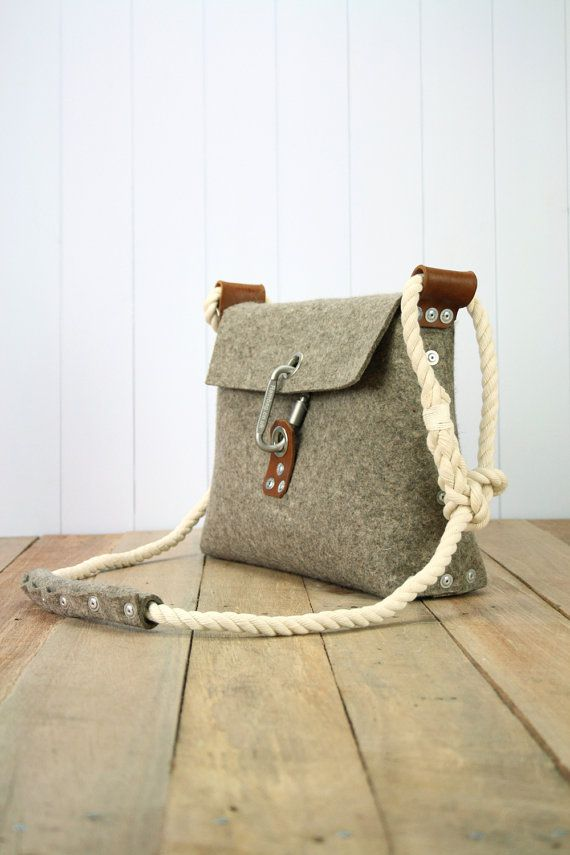 Felt bag with carabiner buckle and rivet fastenings. by Rambag