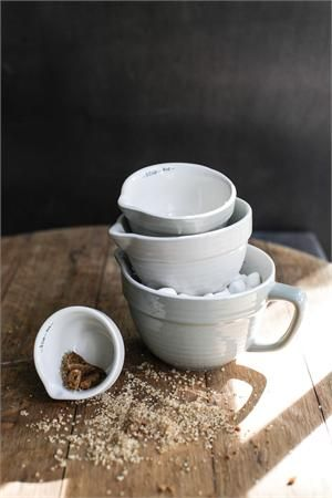 The perfect tool for any country kitchen, this set of four Farmhouse Stoneware Measuring Cups feature several soft shades of grey, spout for pouring and the cup size printed on the inner rim. Set of four includes 1 1/2 cups or 12oz, 1 cup or 8oz, 1/2 cup or 4 oz and 1/4 cup or 2oz  Microwave, dishwasher and oven safe.