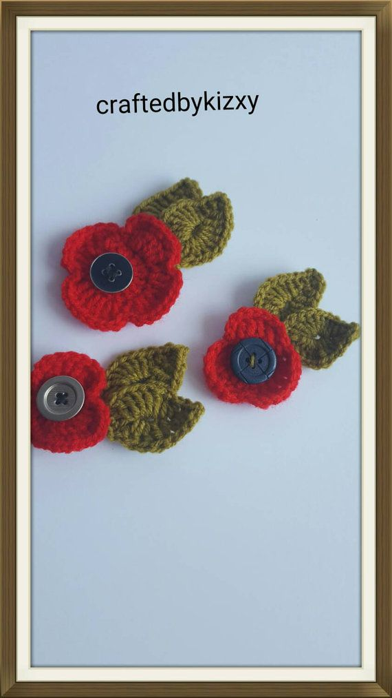 Check out this item in my Etsy shop https://www.etsy.com/uk/listing/246235290/poppy-brooch-with-button-and-leafs