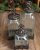 This glass star canister set comes in a set of three and each has a cast iron base and lid with a rustic star design. Canister is dishwasher safe. Hand wash base and lid.       Colors: Clear Home Décor Fort Western Stores offers a huge selection of western wear and decor at low prices including cowboy hats, work wear, cowboy boots, saddles and tack.