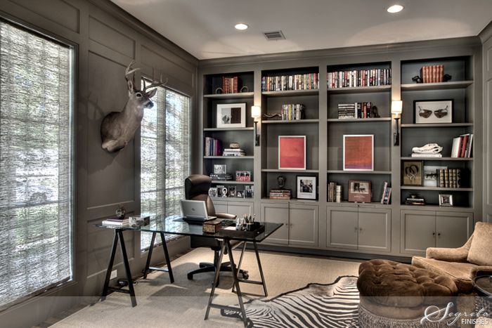 Love the bookcase and walls  all done in the same paint.  Brilliant.  Also always love a zebra rug.