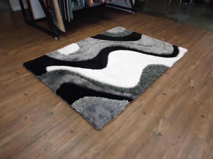 grey with black shag rug with hand carving design