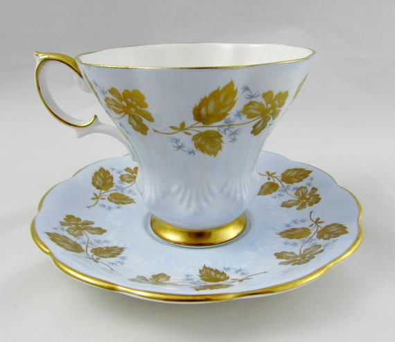 Made by Royal Albert, tea cup and saucer are blue with gold flowers and gold trimming. Tea cup is in the lyric shape. Excellent condition (see photos). Markings read: Royal Albert Bone China England Please bear in mind that these are vintage items and there may be small