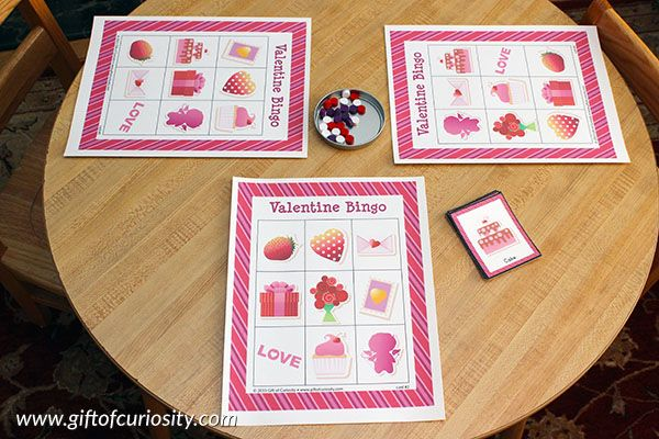 Free printable Valentine Bingo game with 10 different playing cards for hours of Valentine's Day Bingo fun!    Gift of Curiosity