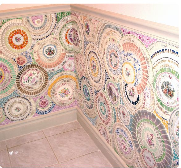 Mosaics using decorative plates.........clever....