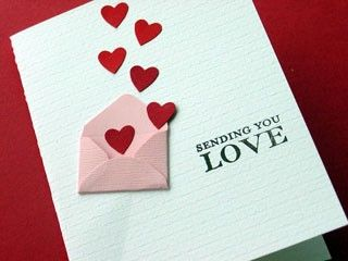 handmade Valentine ... clean and simple ... little pink folded envelope with punched hearts floating out ... background textures ... one layer ... clean and simple ... luv it!