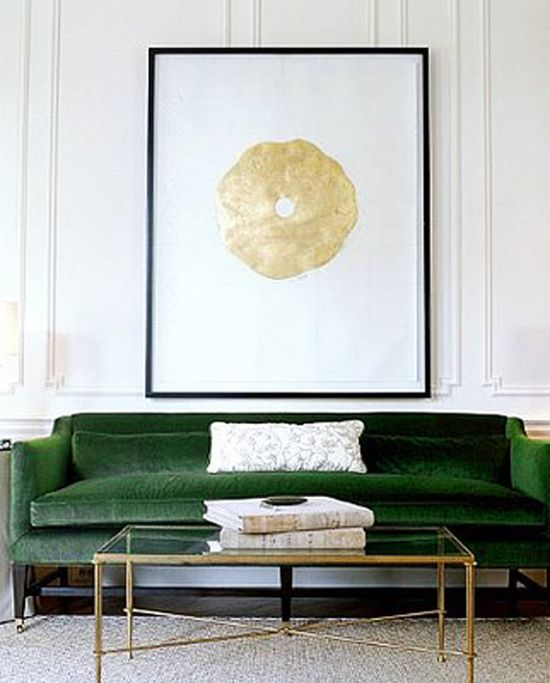 Room Decor Ideas: a simplistic living room with white walls and a glass coffee table. The different touch is given by the Stephen Knollenberg green velvet sofa.
