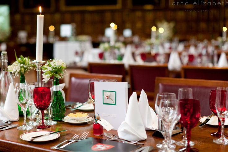 Table set-up with red glasses and silver candelabra