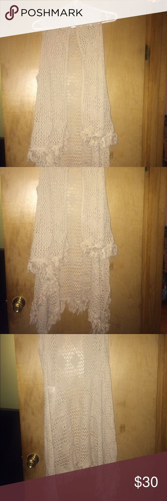 Fringe Sweater Vest. Short in front. Long in back. Beautiful never worn still has tags. From Cracker Barrel. Retailed $42. Asking 30. Firm on price size M Sweaters Shrugs & Ponchos