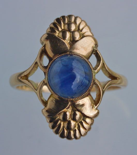 This is not contemporary - image from a gallery of vintage and/or antique objects. EVALD NIELSEN 1879-1958  Skonvirke Ring  Gold Sapphire