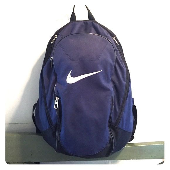 Nike sport backpack Nike backpack, navy blue and in good condition! Has five zip up/down compartments to hold books, pencils, and gym clothes! Very strong, not easily torn. There is a little fading on the Nike symbol on the front. Nike Bags Backpacks