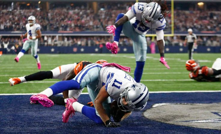 Bengals vs. Cowboys:    October 9, 2016  -  28-14, Cowboys  -    Dallas Cowboys player Cole Beasley runs the ball in for a touchdown against the Cincinnati Bengals in the first half of their game at AT
