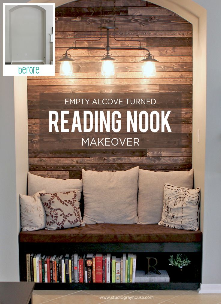 Cozy reading nook in an empty alcove with wood plank wall. Click through to see more details about this transformation plus, free plans to build your own reading nook bench!