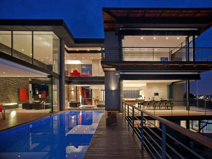 This would be a bomb ass house to live in.. But I don't know if I would want all that open visibility (so much glass)