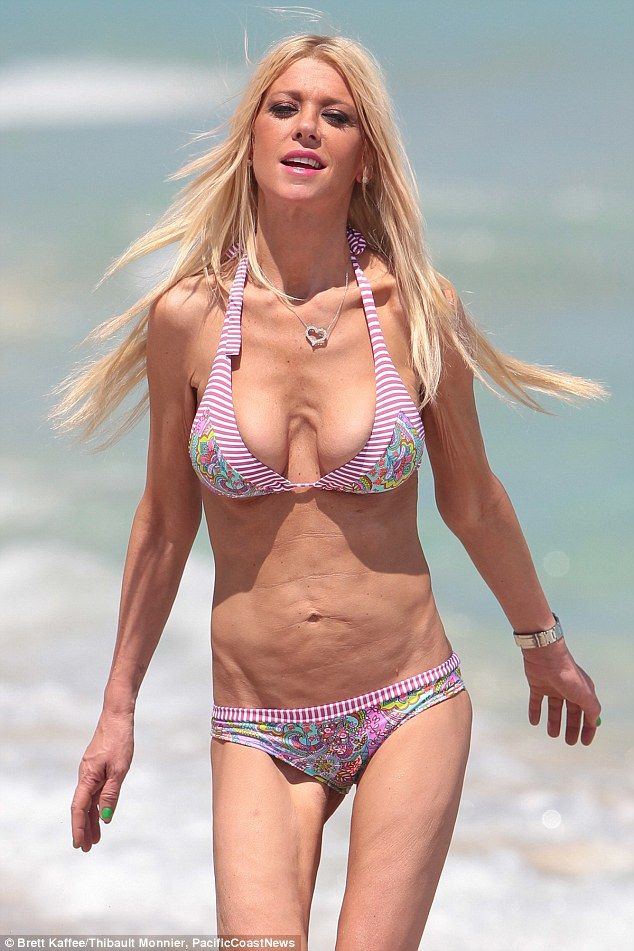 Too thin? Tara Reid looked worryingly slender as she posed in a bikini on the beach on Friday