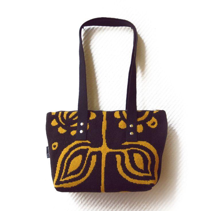 """Bag made from woven textile """"täkänä""""."""